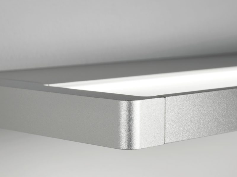 Close up of Derungs Zera light. Stylish curved edges.