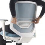 Herman Miller Express 2 Task Chair with Mesh Back and Adjustable Lumbar. Showing a user adjusting the adjustable lumbar