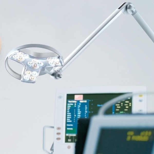 Derungs Visiano 20-2 Examination Light - Spring Balanced Arm over meidcal devices in a hospital